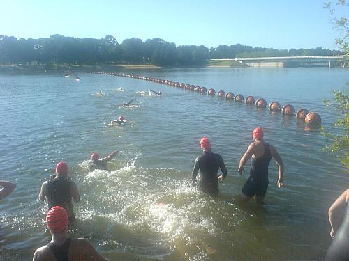 Individual swimmers head out to the start line