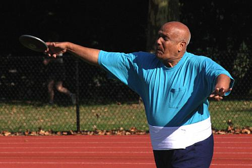 Sri Chinmoy throwing the discus.