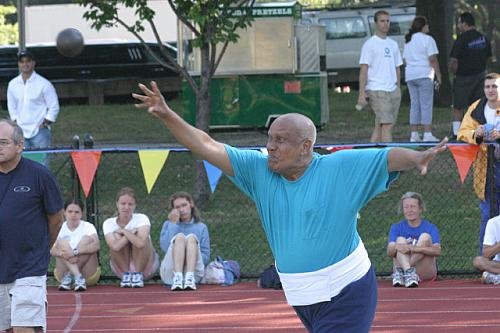 Sri Chinmoy launches the shot put.