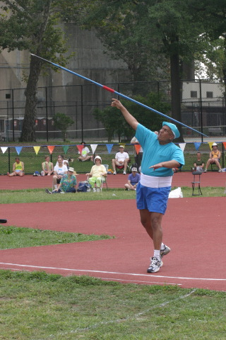 Sri Chinmoy throwing the javelin.