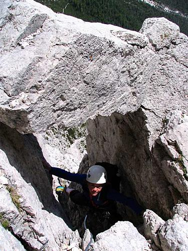 "climbing through a chimney - Punta Fiames ""Via Comune"""